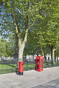 Postboxes Posters - British red letter box and public telephone box in London Poster by Stefano Baldini