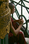 Buddhist Monk Posters - Buddhist Monk Leaning Against A Pillar Sule Pagoda Central Yangon Myanar Poster by ArtPhoto-Ralph A  Ledergerber-Photography