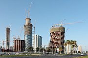 Tower Crane Posters - Building Doha tower by tower Poster by Paul Cowan
