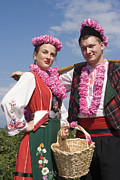 The Lady In Red Photos - Bulgaria lady and Bulgarian man in traditional costume dress  by Cliff  Norton