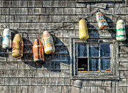 Old Fishing Gear Framed Prints - Buoys on a Wall at Peggys Cove Framed Print by Rob Huntley