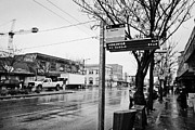 Busstop Prints - bus stop on main street heading downtown from mount pleasant on a wet day Vancouver BC Canada Print by Joe Fox