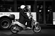 Business-travel Framed Prints - Business man in suit and white helmet on scooter commutes past bus full of passengers through Piazza Framed Print by Joe Fox