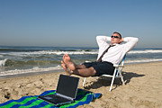 Beach Towel Prints - Businessman on beach relaxing Print by Joe Belanger