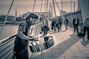Steel Drums Photo Posters - Busker playing steel band drum steelpan in London Poster by Peter Noyce
