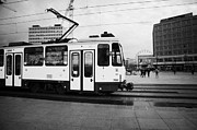 Alexanderplatz Prints - BVG berlin yellow tram travelling though alexanderplatz Berlin Germany Print by Joe Fox
