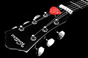 Guitars Photos - BW Head Stock With Red Pick  by Andee Photography
