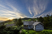 Sky Mountaintops Posters - Cabins at Dawn Poster by Debra and Dave Vanderlaan