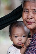 Pouting Prints - Cambodian Grandmother and Baby #3 Print by Nola Lee Kelsey