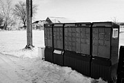 Harsh Conditions Prints - canada post post mailboxes in rural small town Forget Saskatchewan Canada Print by Joe Fox