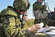 Strategy Posters - Canadian Army Captain Radios A Close Poster by Stocktrek Images