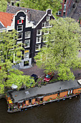 City Canal Prints - Canal Houses and Houseboat in Amsterdam Print by Artur Bogacki