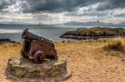 Gravel Prints - Cannon at Llanddwyn  Print by Adrian Evans