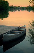 Canoe At A Dock At Sunset Print by Jill Battaglia