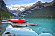 Alberta Framed Prints - Canoes of Lake Louise Alberta Canada Framed Print by George Oze