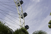 Tourists Posters - Capsules and structure of the Singapore Flyer along with the spok Poster by Ashish Agarwal