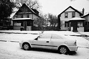 Sask Photo Posters - car covered in snow parked by the side of the street in front of residential homes caswell hill Sask Poster by Joe Fox