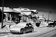 Suburbs Posters - car covered in snow parked outside houses in the suburbs of Saskatoon Saskatchewan Canada Poster by Joe Fox