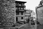 Antic Car Prints - Car Driving Through Narrow Streets Of Old Town Of Medieval Baga Catalonia Spain Print by Joe Fox