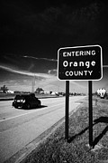Entering Posters - Car Entering Orange County On The Us 192 Highway Near Orlando Florida Usa Poster by Joe Fox
