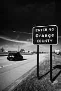 Car Entering Orange County On The Us 192 Highway Near Orlando Florida Usa Print by Joe Fox