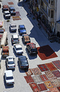 Carpet Photo Posters - Carpets and cars on the road in Baku Old Town Azerbaijan Poster by Robert Preston