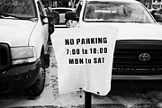 No Parking Prints - cars parked beside no parking cover on a parking meter during winter Saskatoon Saskatchewan Canada Print by Joe Fox