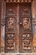 Religious Art Photos - Carved wooden door at Bhaktapur in Nepal by Robert Preston