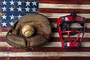 Round Framed Prints - Catchers glove on American flag Framed Print by Garry Gay