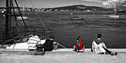 North Wales Photos - Catching Crabs In Red by Meirion Matthias