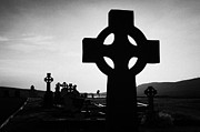 Celts Prints - Celtic Cross Silhouetted At Sunset In Graveyard At Dunlewey Church Donegal Ireland Print by Joe Fox