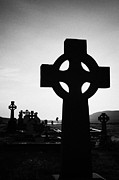 Celts Photo Posters - celtic cross silhouetted at sunset in graveyard at dunlewey church dunlewy county Donegal Republic of Ireland Poster by Joe Fox