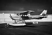 Fitted Prints - cessna 172L fixed wing single engine seaplane key west international airport florida keys usa Print by Joe Fox