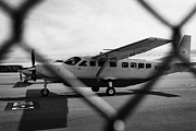 Cessna Photos - cessna 208B sightseeing tour aircraft at Grand canyon west airport Arizona USA by Joe Fox
