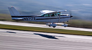 Cessna Photos - Cessna Takeoff by John Daly