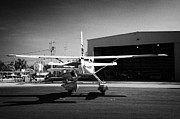 Single-engine Photo Prints - Cessna U206g Fixed Wing Single Engine Seaplane In Front Of Hangar Key West International Airport Flo Print by Joe Fox
