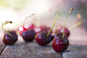 Bokeh Photo Framed Prints - Cherry Delites Framed Print by Juli Scalzi