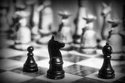 Chessmen Photos - Chess Game in black and white by Paul Ward