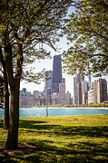 Downtown Prints - Chicago Skyline and Hancock Building Through Trees Print by Paul Velgos