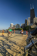 Joggers Prints - Chicagos lakefront bike path on a summer evening Print by Sven Brogren