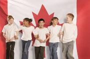 Bond Girls Framed Prints - Children In Front Of Canadian Flag Framed Print by Don Hammond