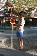 Pour Photo Originals - Children pour sand by Deyan Georgiev