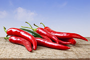 Chilli Posters - Chilli Peppers on Rustic Background Poster by Colin and Linda McKie