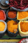 Colours Photos - Chilli powders 3 by James Brunker