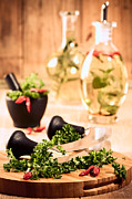 Olive Oil Photo Prints - Chopping Herbs Print by Christopher and Amanda Elwell