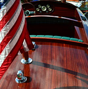 Wooden Boat Photos - Chris Craft with Flag and Steering Wheel by Michelle Calkins