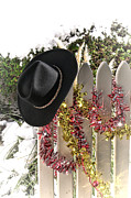 Holiday Greeting Posters - Christmas Cowboy Hat on a Fence Poster by Olivier Le Queinec