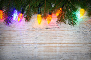 Christmas Lights Prints - Christmas lights with pine branches Print by Elena Elisseeva