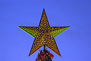Star Posters - Christmas star during dusk time Poster by George Atsametakis