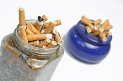 Cigarette Posters - Cigarettes butts in jar and ashtray Poster by Sami Sarkis